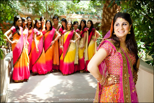 indian_wedding_bridesmaids_multicolored_sari_bride_pink_yellow_gold_background